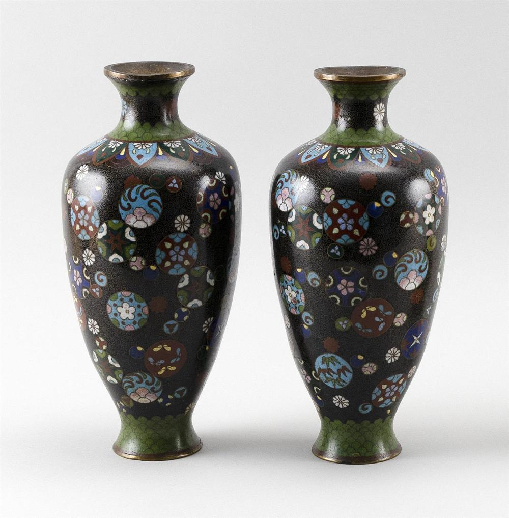 PAIR OF JAPANESE CLOISONNÉ ENAMEL VASES In rouleau form, with decoration of a floral mon on a black ground. Height 10