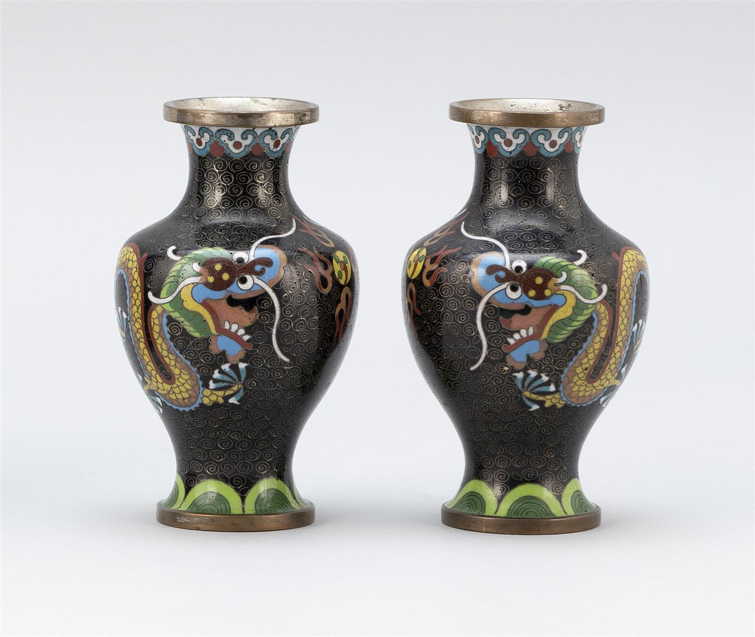 "PAIR OF JAPANESE CLOISONNÉ ENAMEL VASES In baluster form, with dragon and fiery pearl decoration on a black ground. Heights 5""."