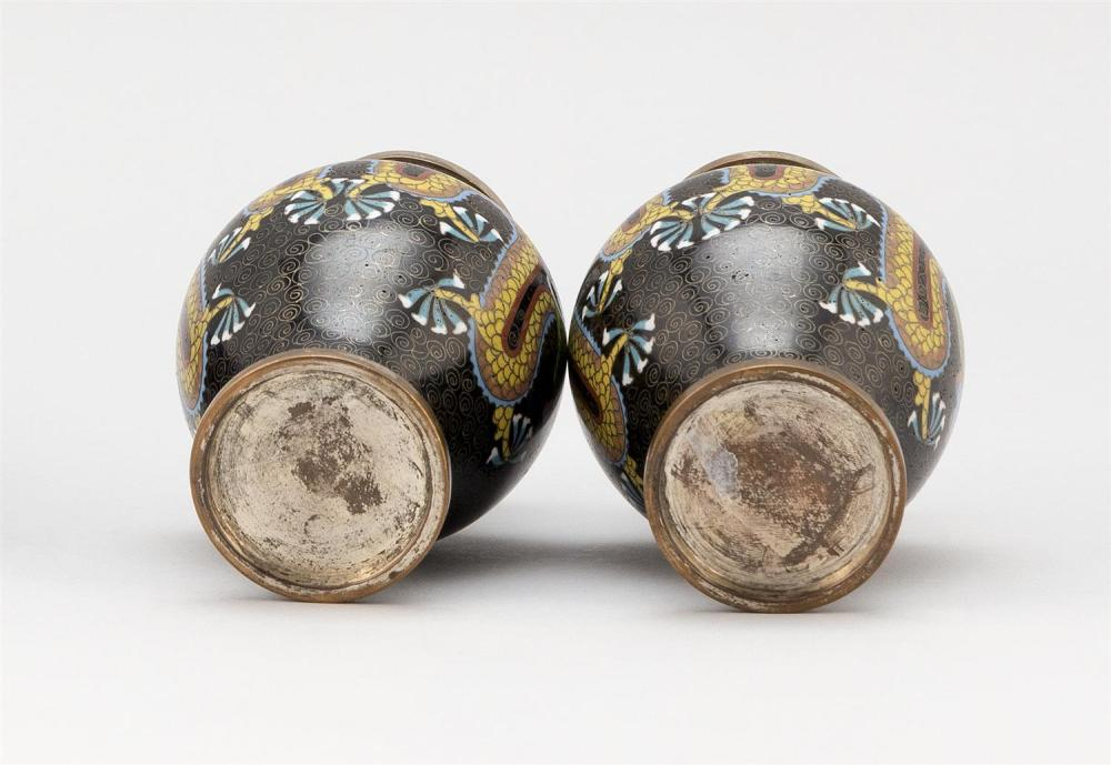 PAIR OF JAPANESE CLOISONNÉ ENAMEL VASES In baluster form, with dragon and fiery pearl decoration on a black ground. Heights 5