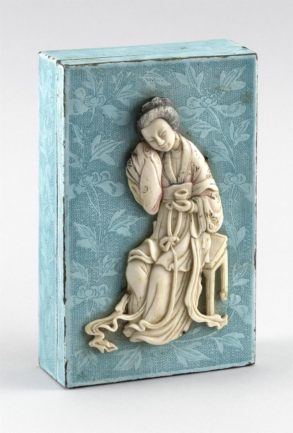 JAPANESE LIGHT GREEN ENAMEL AND SILVER METAL BOX With engraved floral decoration and a raised ivory meijin figure on cover. Height 1...
