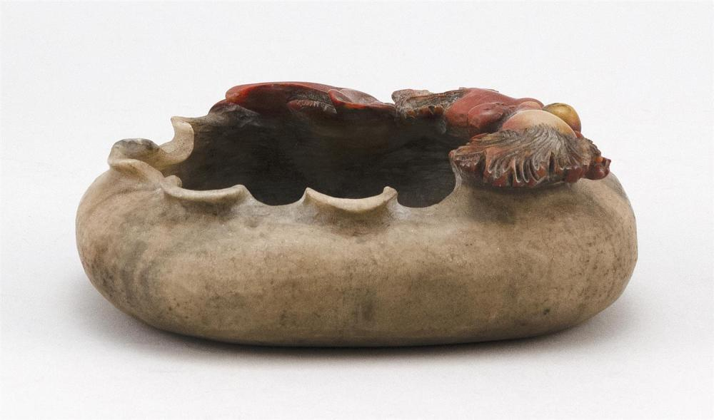 CHINESE TWO-COLOR SOAPSTONE WRITER'S COUPE In the form of a folded lotus leaf and two fantail carp. Inscribed calligraphy on base. L..