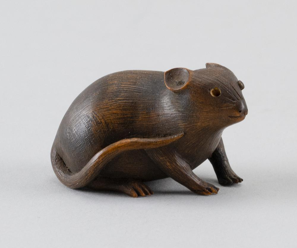 WOOD NETSUKE By Suketsugu. In the form of a rat with inlaid eyes. Signed.