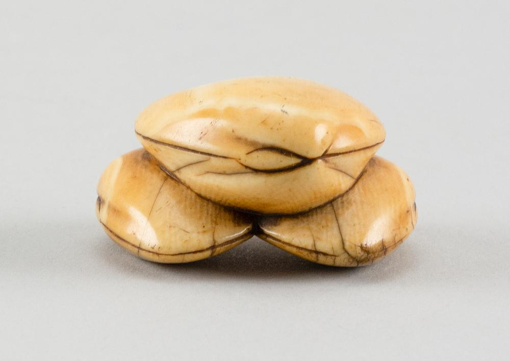 IVORY NETSUKE In the form of a crab crawling out of a clamshell mountain. Height 1.8