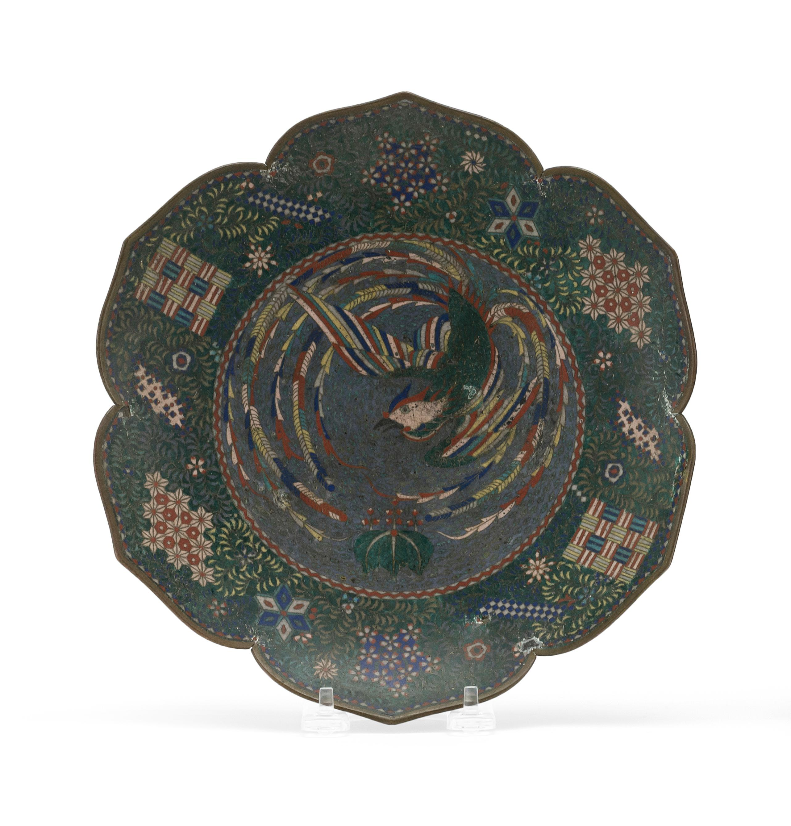 JAPANESE CLOISONNÉ ENAMEL PLATE Attributed to Kaji Tsunekichi (1803-1883). In six-petal flower form. Obverse with decoration of ho b...
