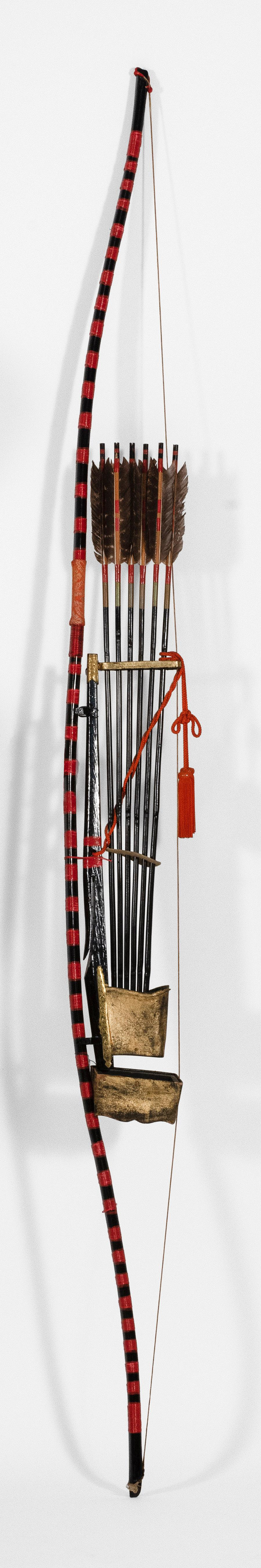 "JAPANESE DECORATIVE BOW, QUIVER AND SIX ARROWS Red and black lacquer bow. Quiver with gilt mounts. Bow length 82""."