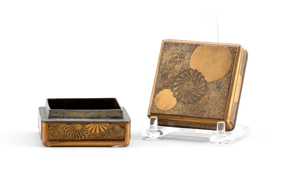 JAPANESE GOLD LACQUER INCENSE BOX Square, with pewter rim and chrysanthemum decoration. 2.4