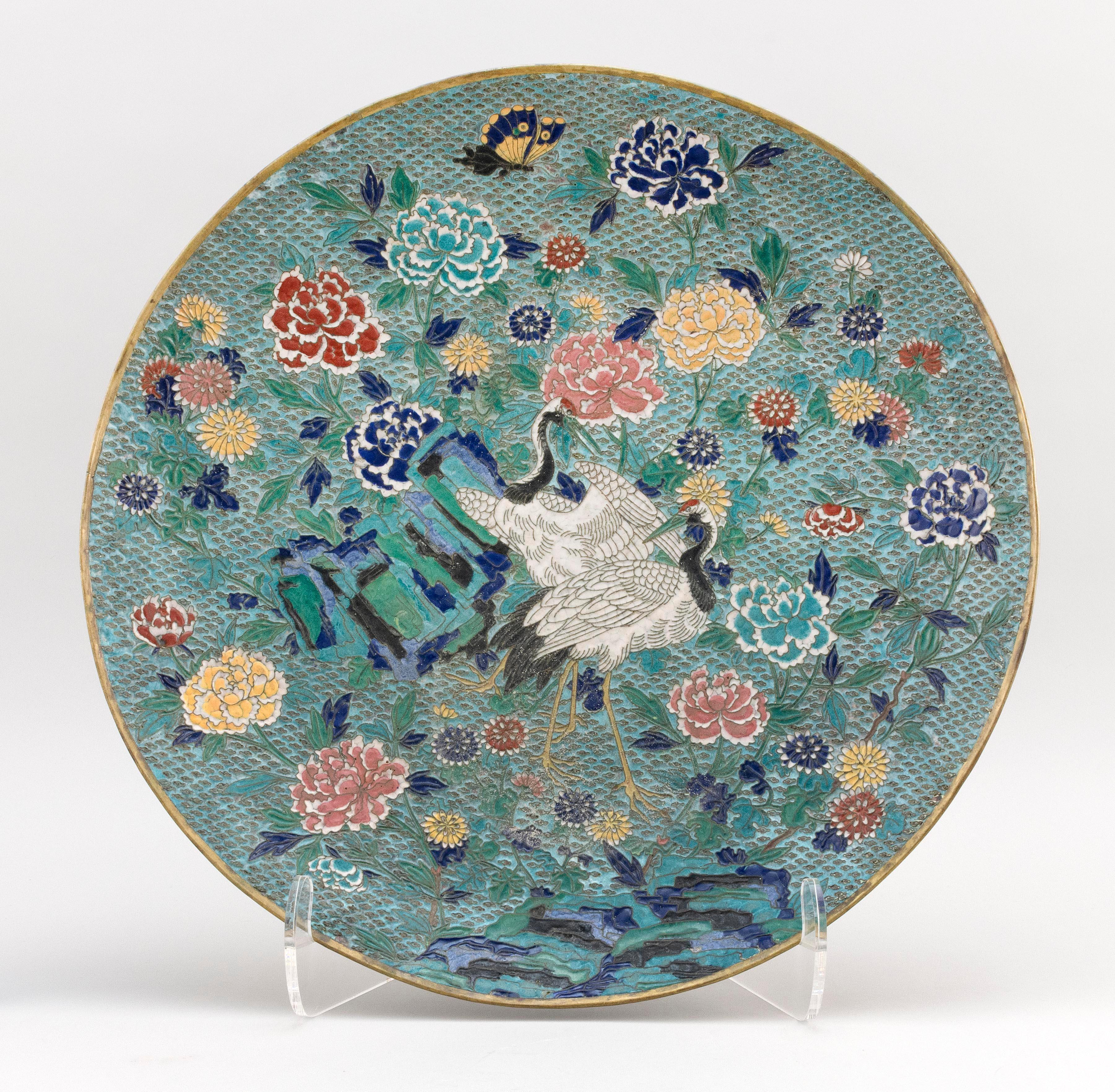 "JAPANESE SCULPTED ENAMEL CHARGER Obverse with crane and peony decoration. Underside in a floral pattern. Diameter 18""."