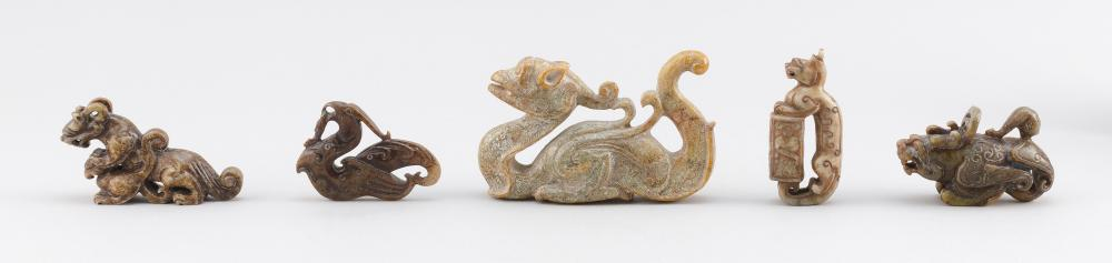 FIVE CHINESE ARCHAIC-STYLE CARVED JADE FIGURES Mostly mottled gray/green jade in the form of qilin. Lengths from 3