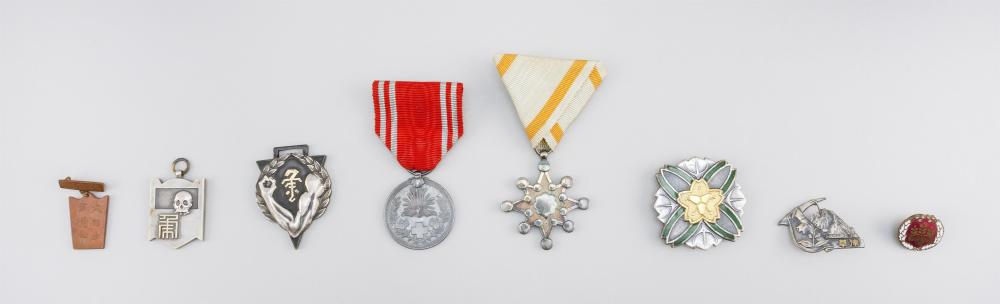 COLLECTION OF EIGHT JAPANESE METALWORK BADGES AND AWARDS