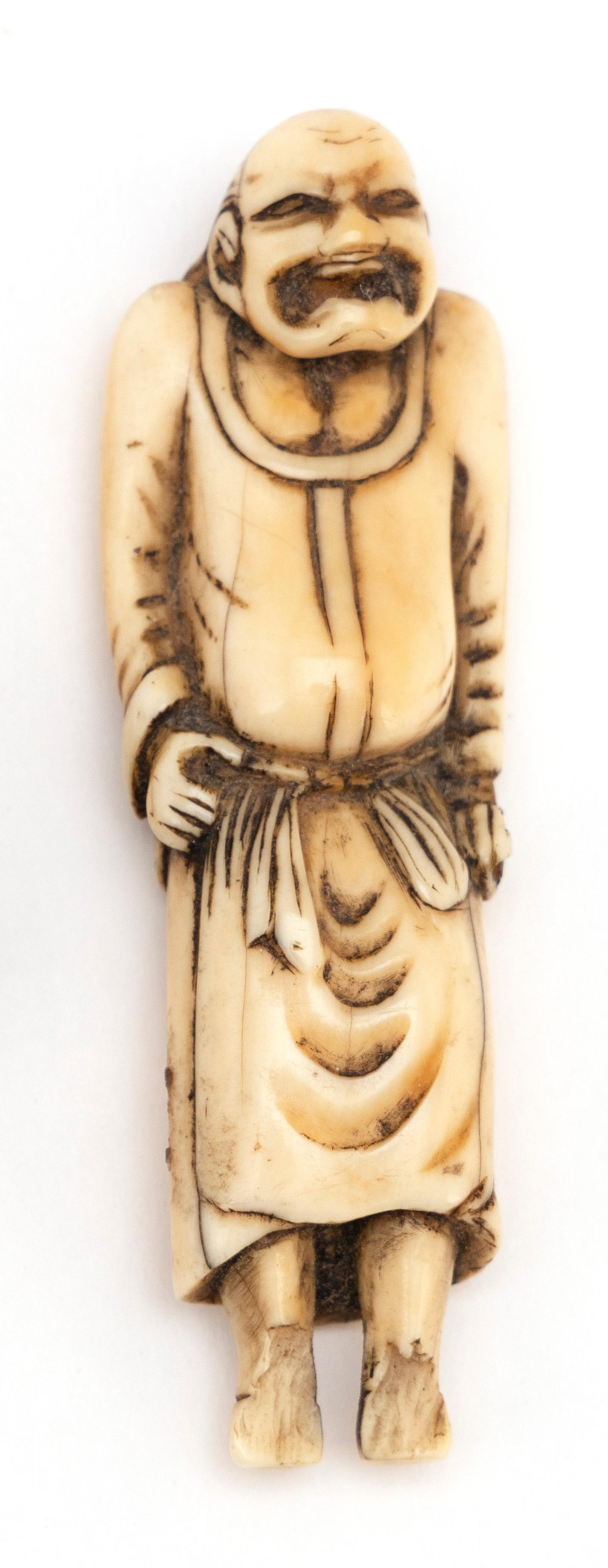 """IVORY NETSUKE In the form of a standing sennin. Height 3.8""""."""