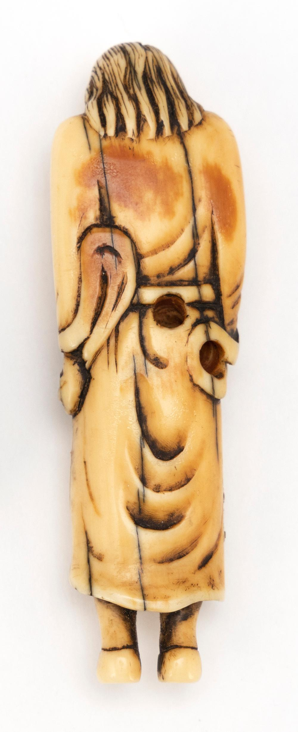 IVORY NETSUKE In the form of a standing sennin. Height 3.8