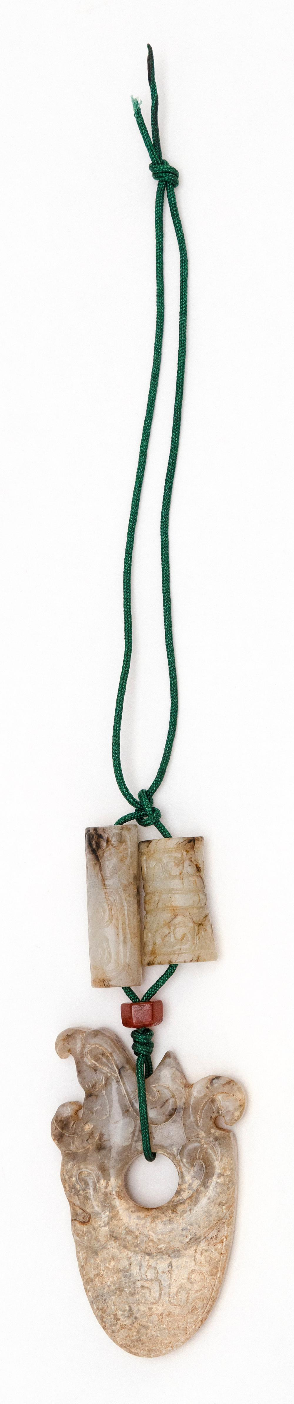 """CHINESE GRAY JADE PENDANT WITH TWO BEADS Pendant in axe-head form with phoenix carving. Length 2.75"""". Cylindrical beads with scroll..."""