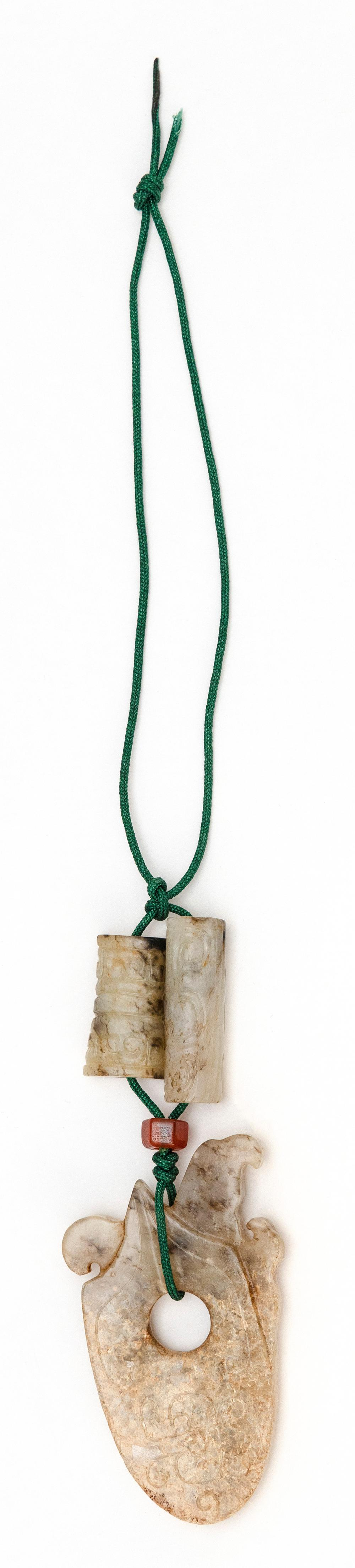 CHINESE GRAY JADE PENDANT WITH TWO BEADS Pendant in axe-head form with phoenix carving. Length 2.75