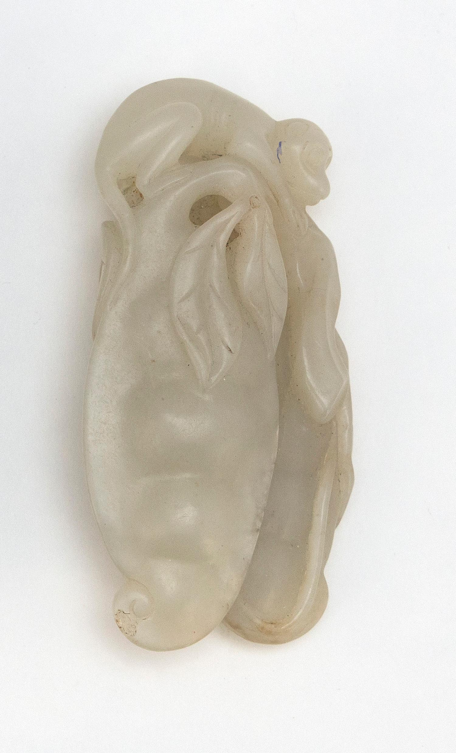 """CHINESE PALE CELADON JADE PENDANT In the form of a monkey with two large peapods. Length 3.2""""."""