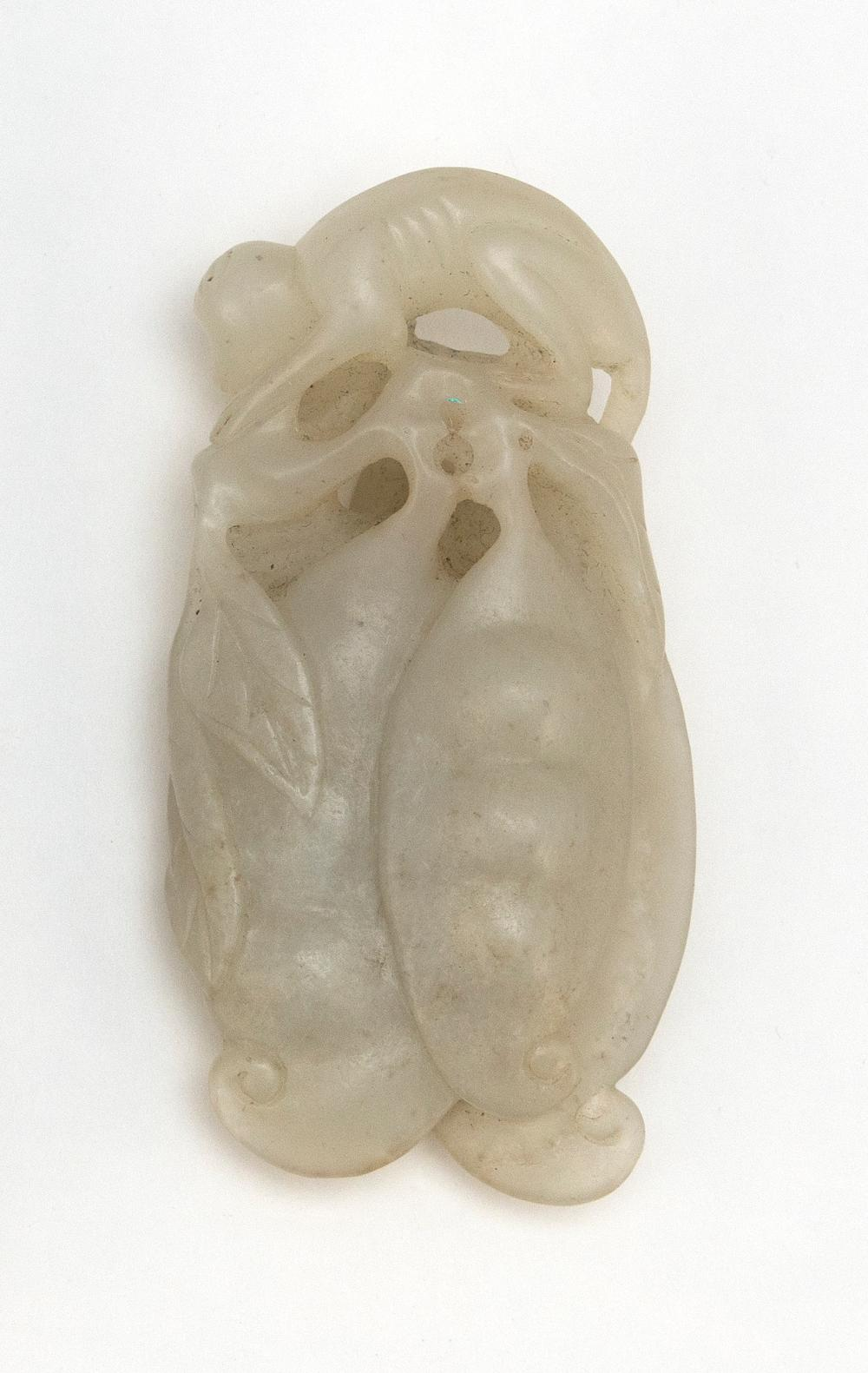 CHINESE PALE CELADON JADE PENDANT In the form of a monkey with two large peapods. Length 3.2