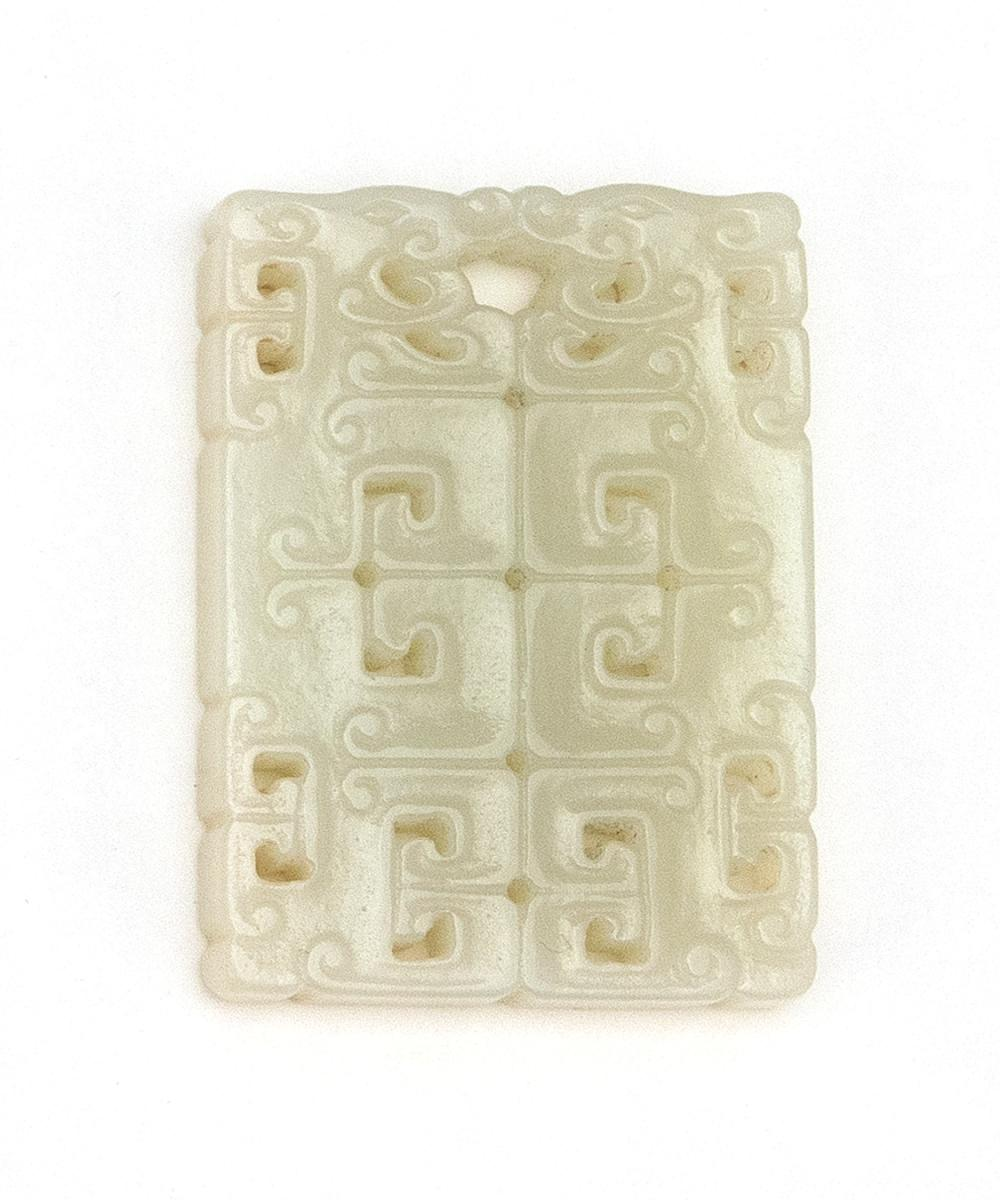 """CHINESE WHITE JADE PENDANT Pierced rectangle, with stylized dragon design. Length 1.8""""."""
