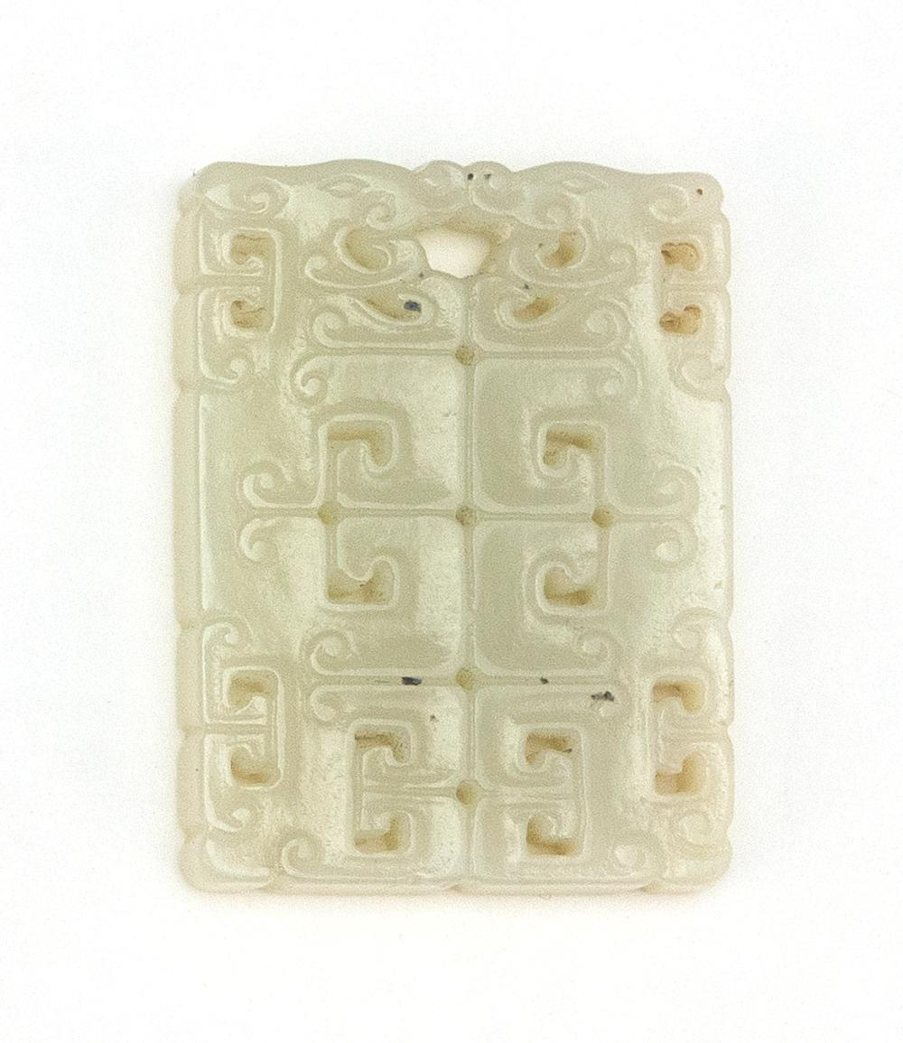 CHINESE WHITE JADE PENDANT Pierced rectangle, with stylized dragon design. Length 1.8