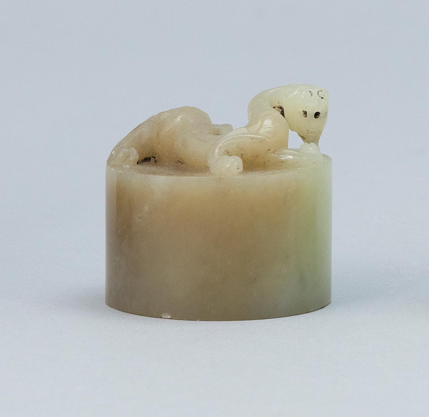 "CHINESE CELADON JADE SEAL Cylindrical, with dragon-form finial. Base cut with four characters. Height 1.4""."