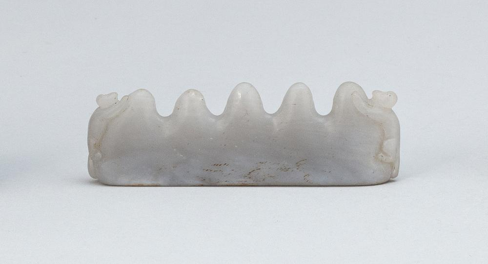 CHINESE GRAY JADE MOUNTAIN-FORM BRUSH REST Two monkeys climbing at the ends. Height 1.5