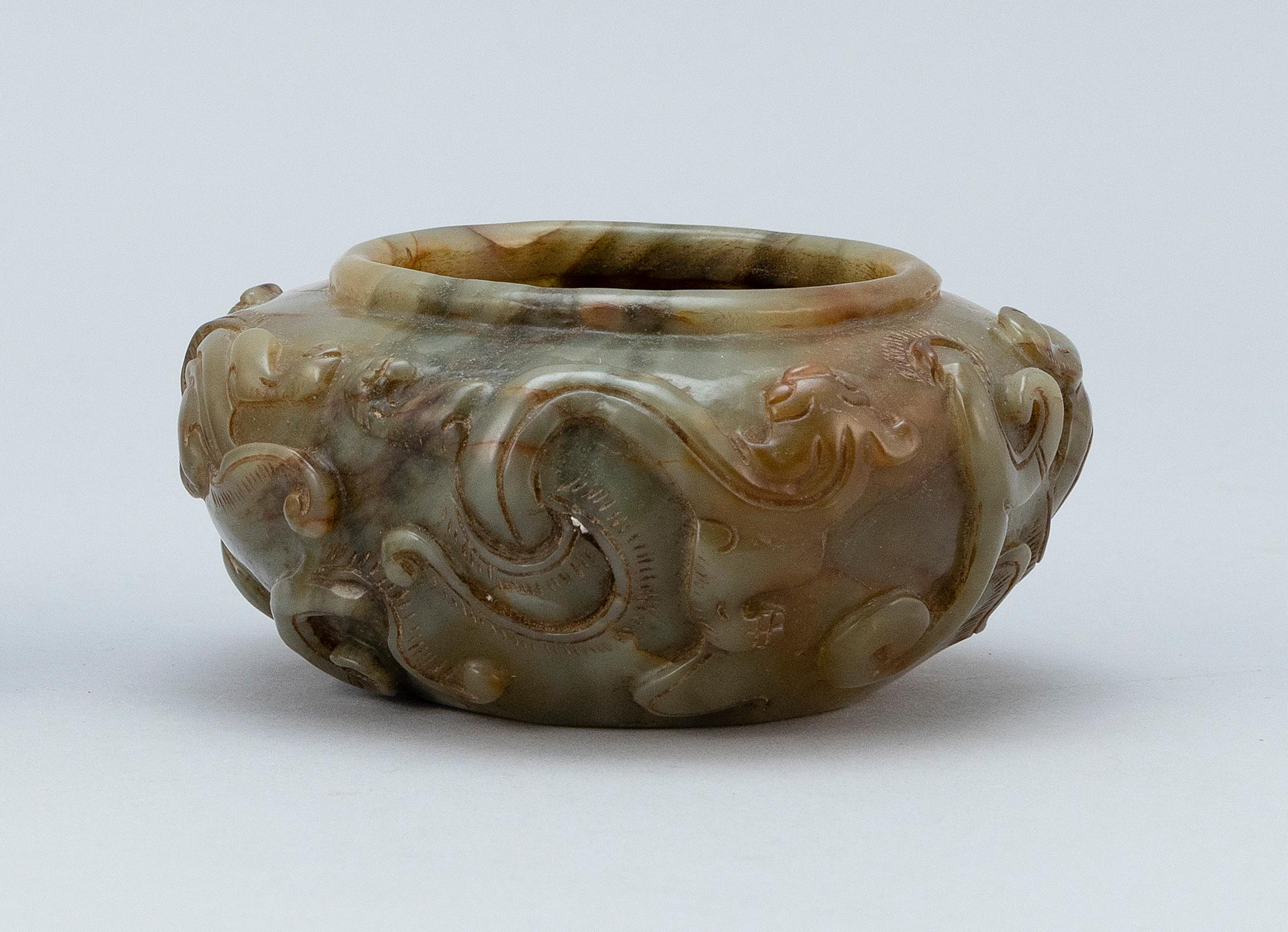 """CHINESE CARVED SAGE GREEN JADE BOWL Raised qilin dragon decoration about the body. Height 2"""". Diameter 3""""."""