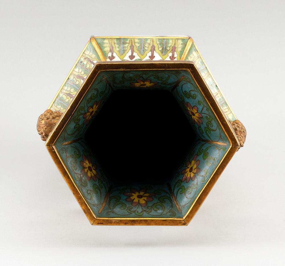 JAPANESE CLOISONNÉ ENAMEL VASE In hexagonal baluster form, with gilt-metal fu dog handles and decoration of flower-filled panels. Fo...