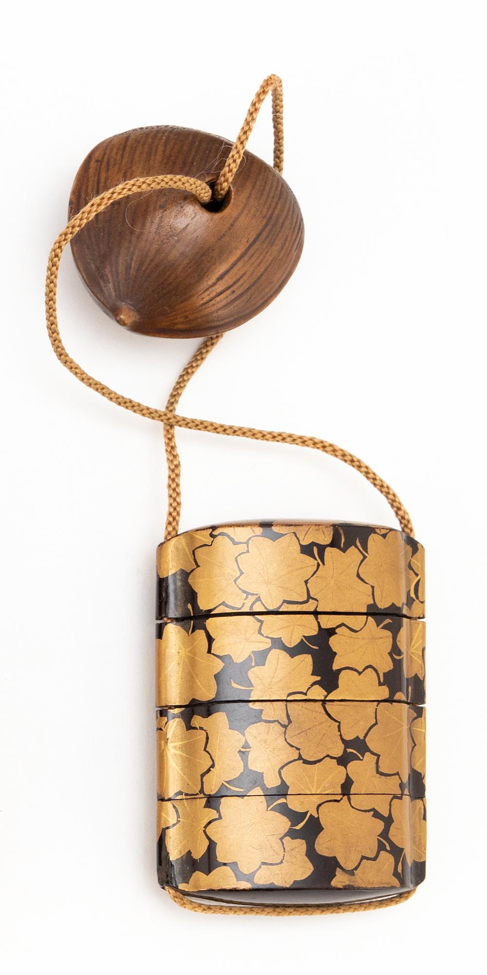 JAPANESE FOUR-CASE GOLD AND BLACK LACQUER INRO Gilt maple leaf design on a black ground. Length 2.75