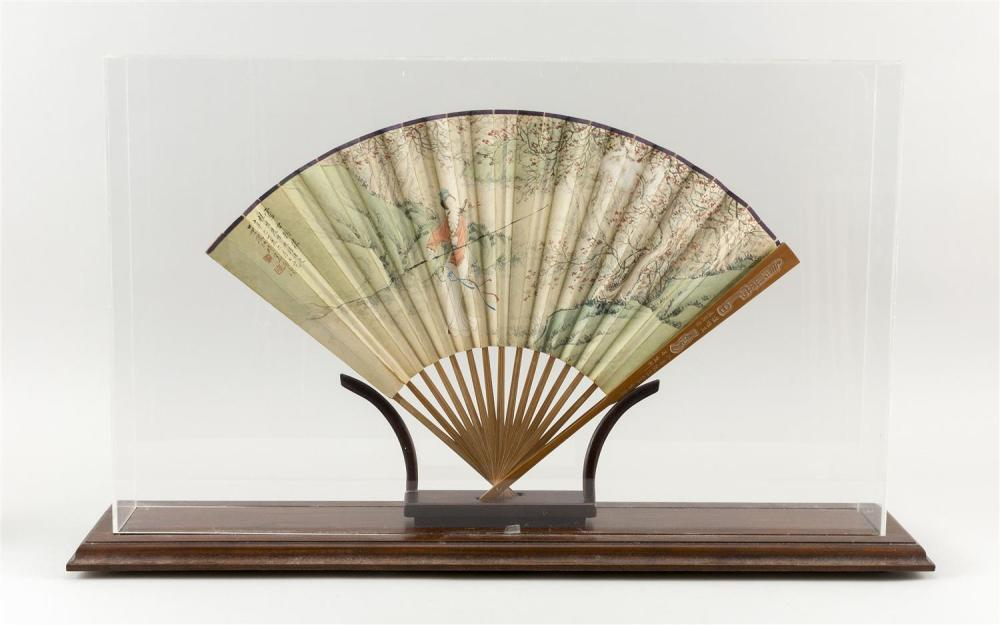 CASED JAPANESE BAMBOO AND PAPER FAN Obverse with finely painted depiction of a woman with a sword and staff within a landscape, with...