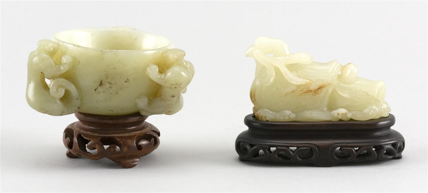"""TWO CHINESE CARVED PALE CELADON JADE PIECES A bowl with three raised qilong dragons along the sides, height 1.5"""" and diameter 2"""", an..."""