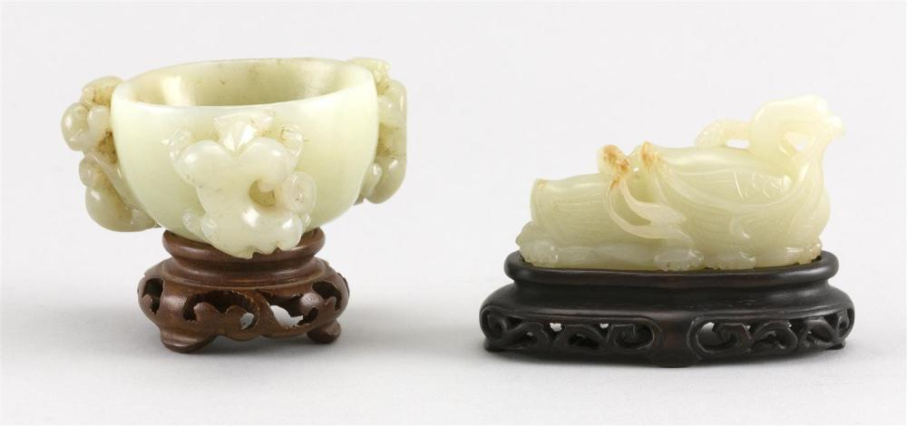 TWO CHINESE CARVED PALE CELADON JADE PIECES A bowl with three raised qilong dragons along the sides, height 1.5
