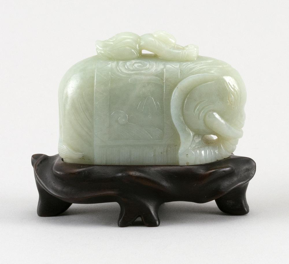 """CHINESE PALE CELADON JADE ELEPHANT With a small child on its back. Height 2"""". Length 3"""". Mounted on a wood stand."""
