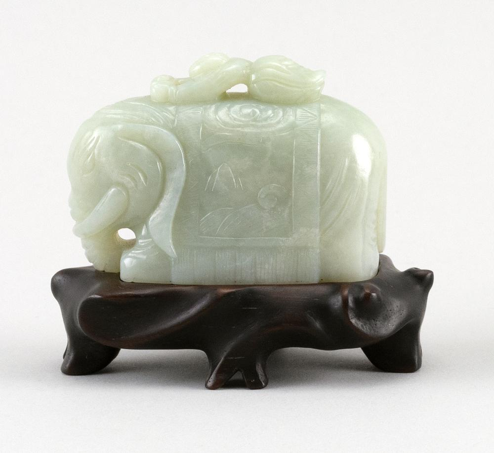 CHINESE PALE CELADON JADE ELEPHANT With a small child on its back. Height 2