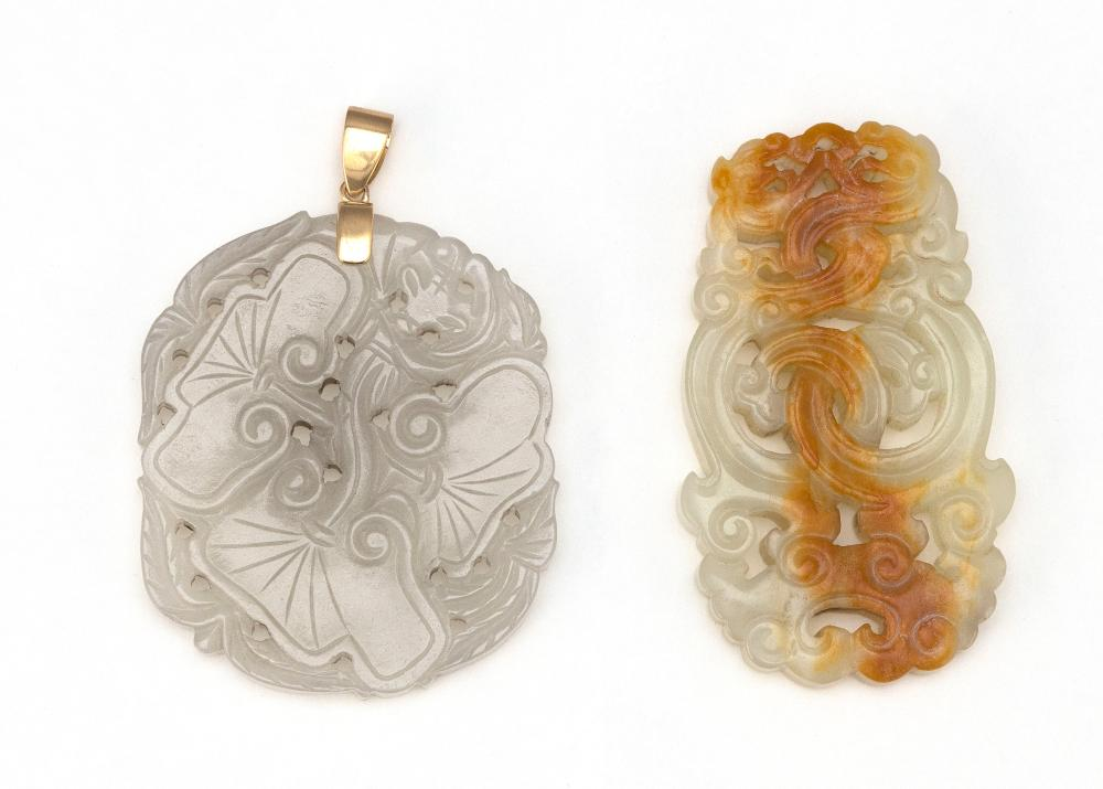 TWO CHINESE CARVED WHITE JADE PENDANTS 1) Openwork-carved in the form of entwined ruyi. Some russet skin tones. Length 2.5