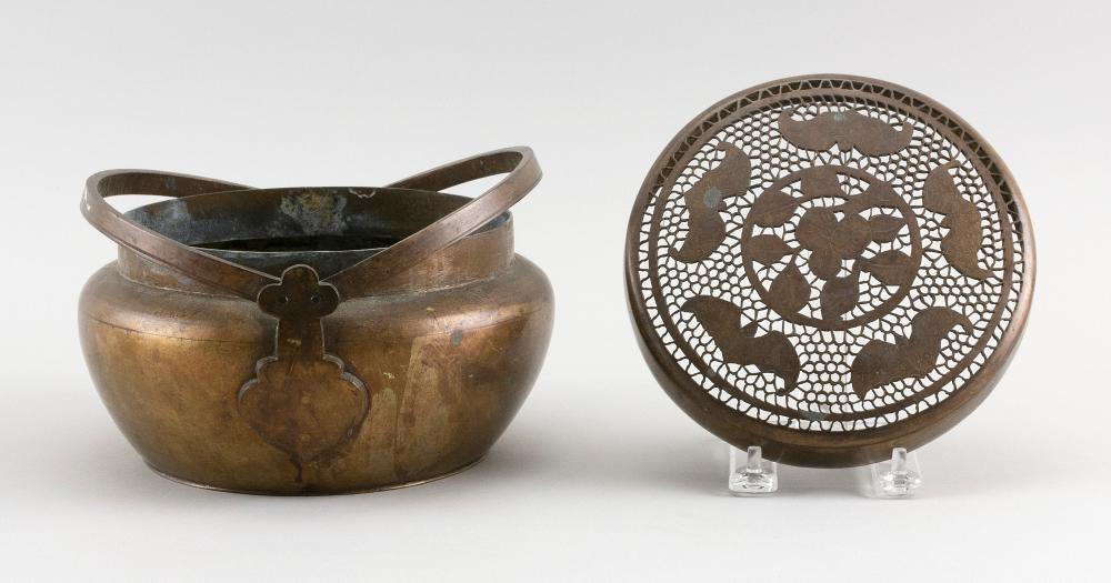 JAPANESE BRONZE HAND WARMER Ovoid, with double swing handle and a pierced cover with central paulownia flower surrounded by bats. He...