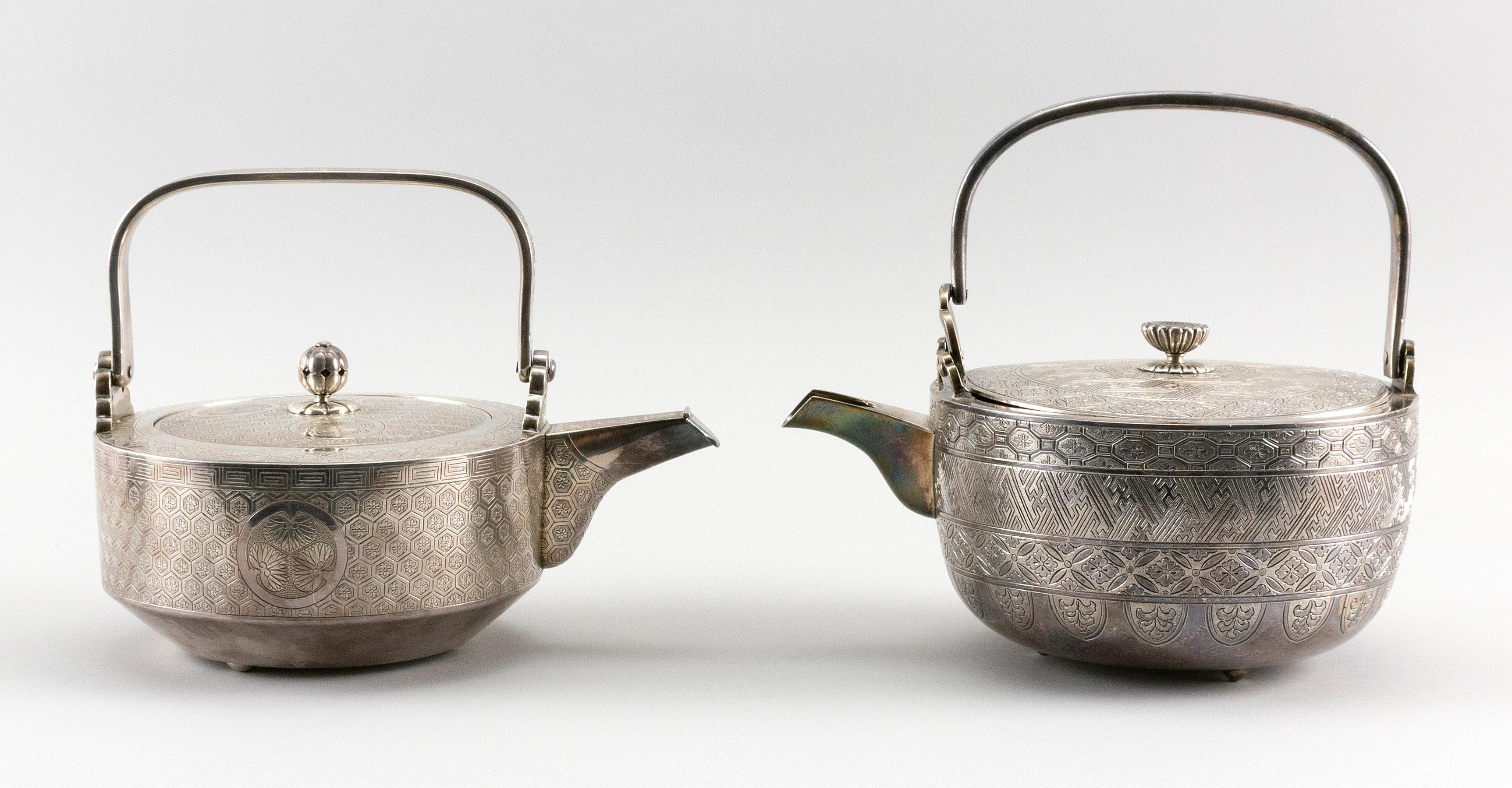 TWO JAPANESE SILVER CHOSHI OR SAKE EWERS Both of typical form, with hand-chased geometric and stylized foliate designs. Both with ha...