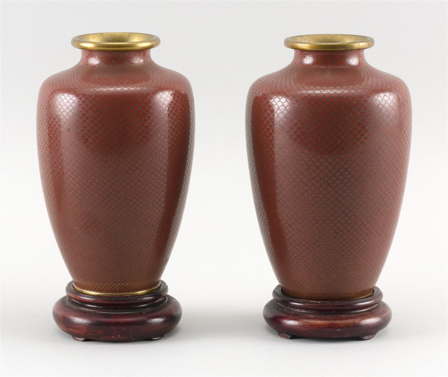 "PAIR OF JAPANESE RED CLOISONNÉ ENAMEL VASES With silver fishscale wirework inlay. Heights 6.5"". With wood stands."