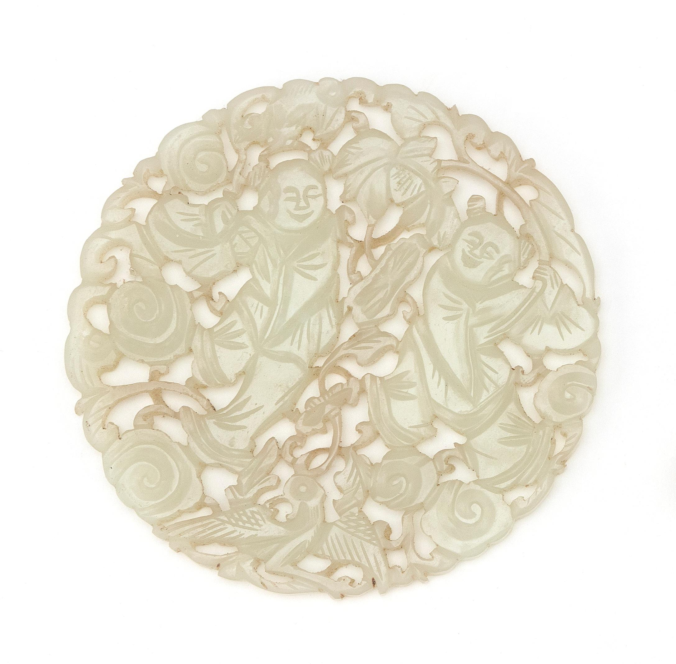 """CHINESE OPENWORK-CARVED CELADON JADE PLAQUE Depicts children with a bat and phoenix in a ruyi-filled landscape. Diameter 3.25""""."""