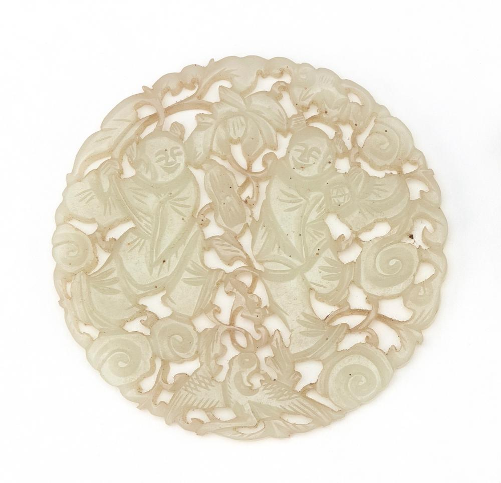 CHINESE OPENWORK-CARVED CELADON JADE PLAQUE Depicts children with a bat and phoenix in a ruyi-filled landscape. Diameter 3.25