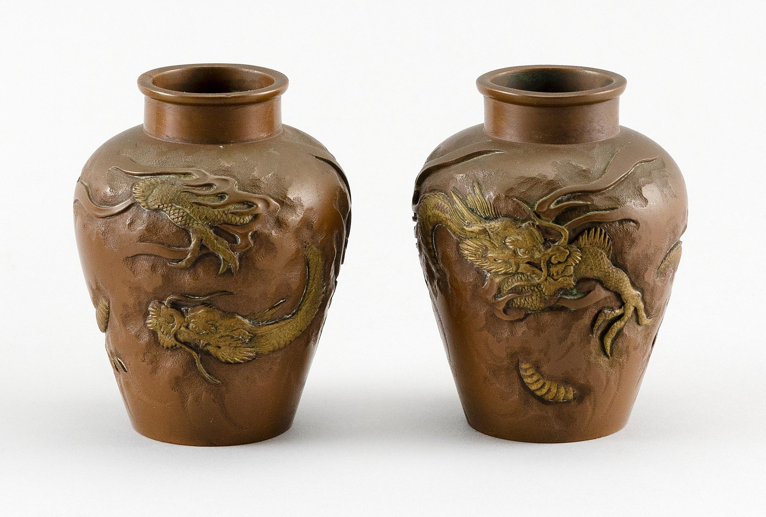 """PAIR OF JAPANESE MINIATURE BRONZE URNS Balustroid, with gilded dragons piercing the surface. Unmarked. Heights 3""""."""