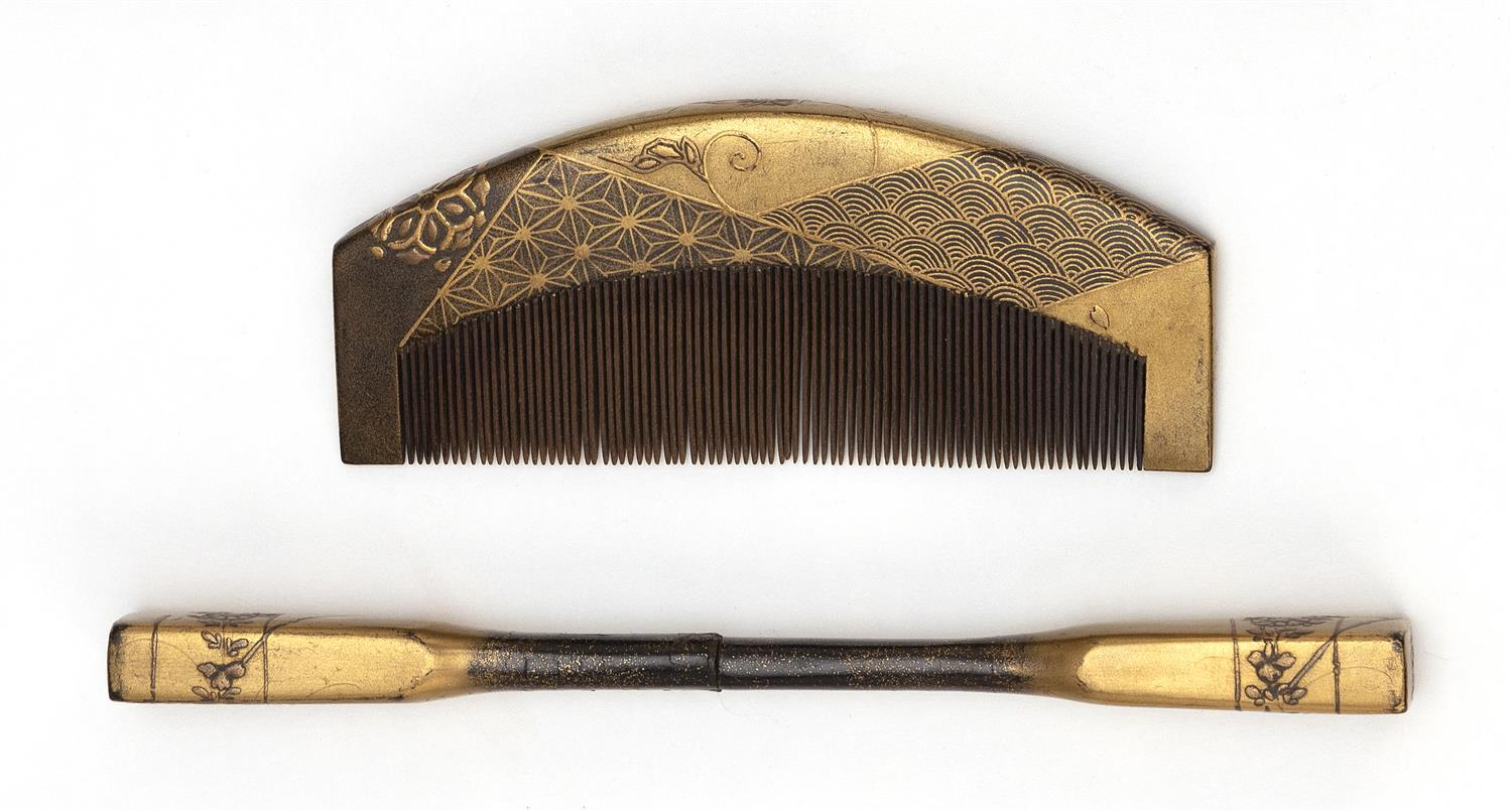 "JAPANESE CASED GILT LACQUER COMB AND KANZASHI Finely rendered brocade and flower decoration. Kanzashi signed. Length 5""."