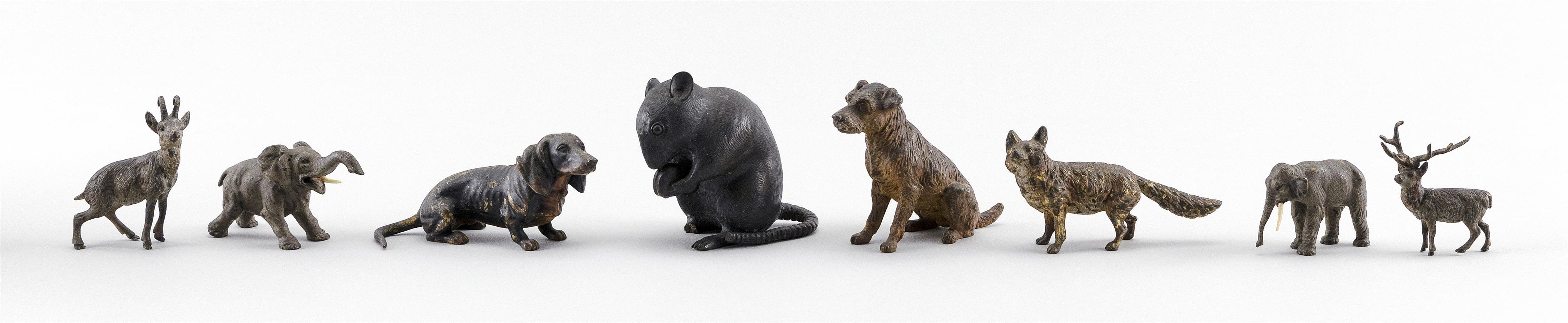 EIGHT JAPANESE AND EUROPEAN BRONZE ANIMAL FIGURES A rat (signed on base), two elephants, two deer, a dachshund, an airedale terrier...