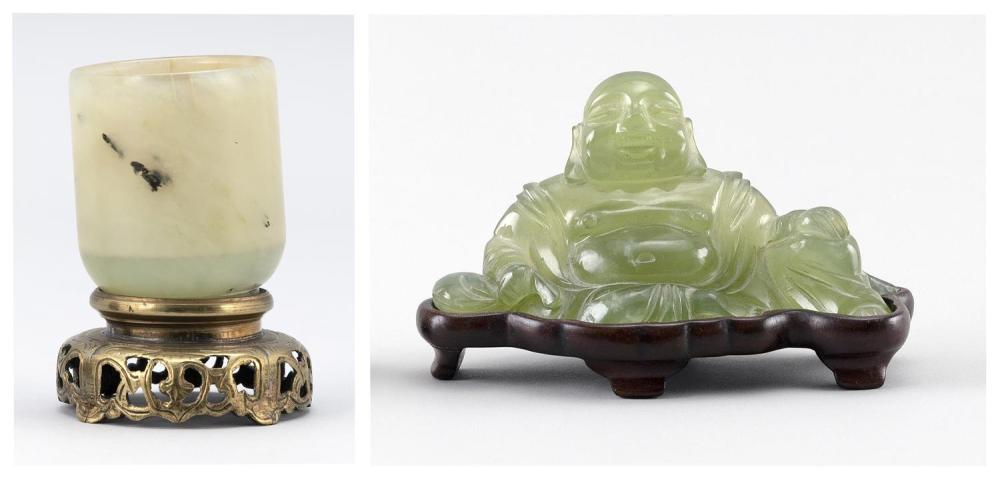 """TWO CHINESE GREEN JADEITE/SERPENTINE PIECES A seated Buddha, length 5"""", mounted on a wood stand, and a cup, height 3"""", mounted on a..."""