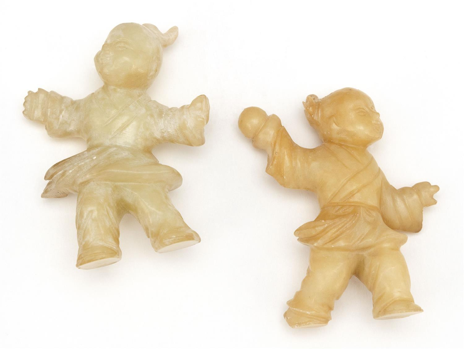"""TWO CHINESE CARVED MUTTONFAT JADE FIGURES In the form of children at play. Heights 2""""."""