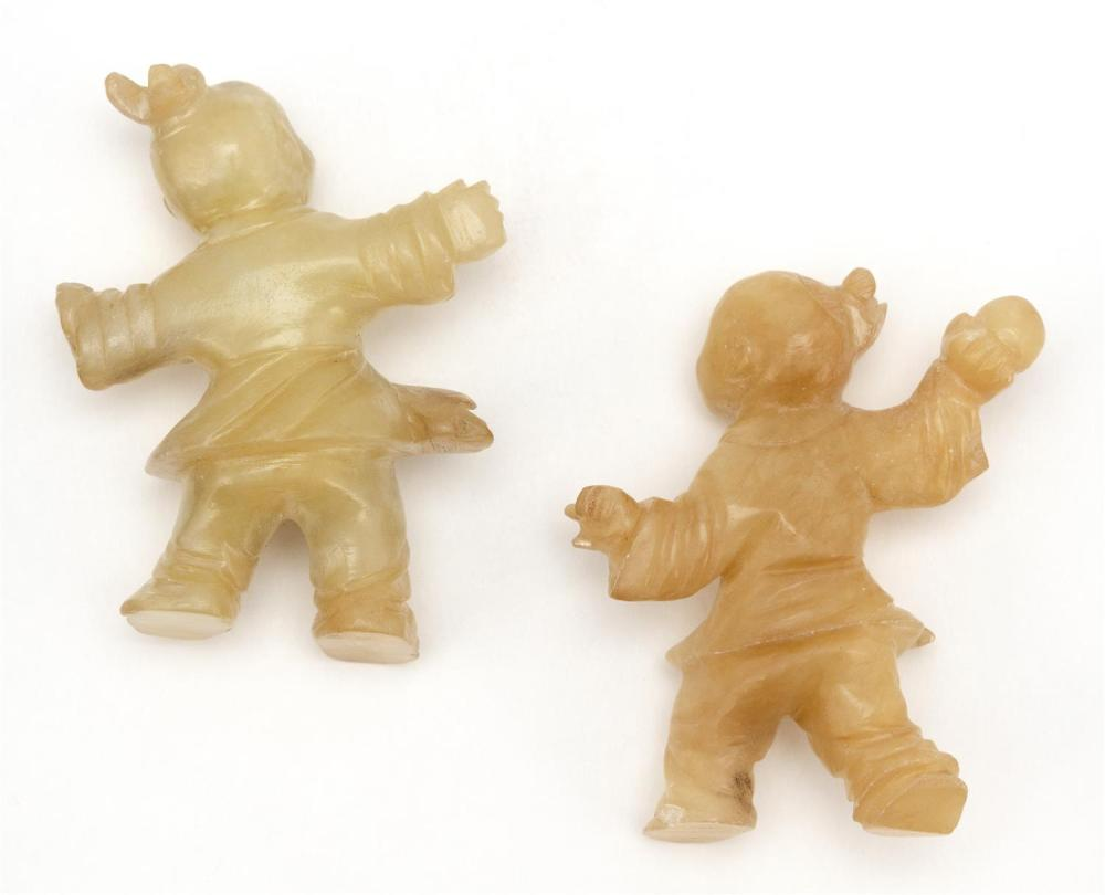 TWO CHINESE CARVED MUTTONFAT JADE FIGURES In the form of children at play. Heights 2