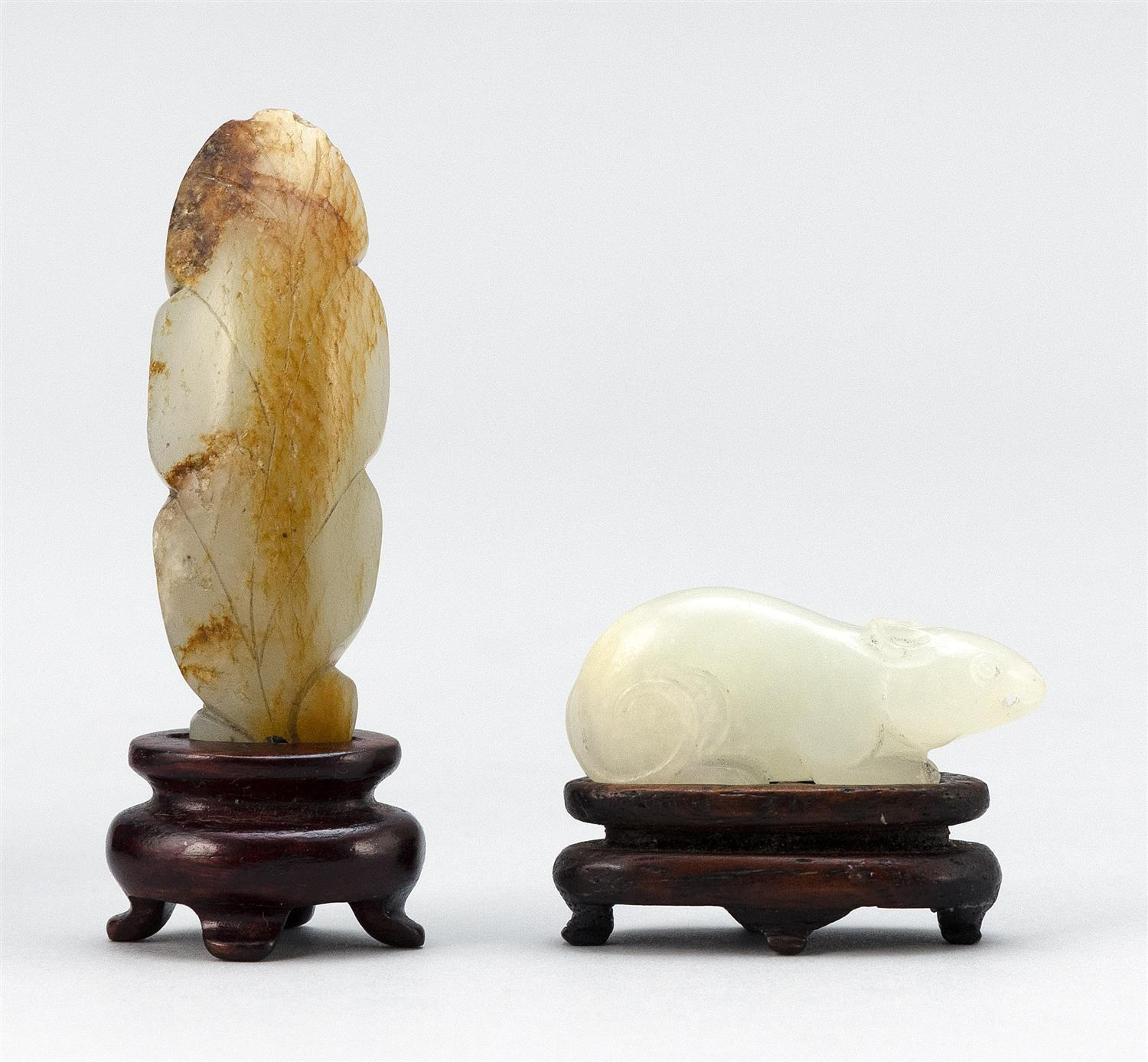 """TWO CHINESE NEPHRITE JADE TOGGLES One in the form of a peapod with russet skin tones, length 2.5"""", and one in the form of a mouse, l..."""