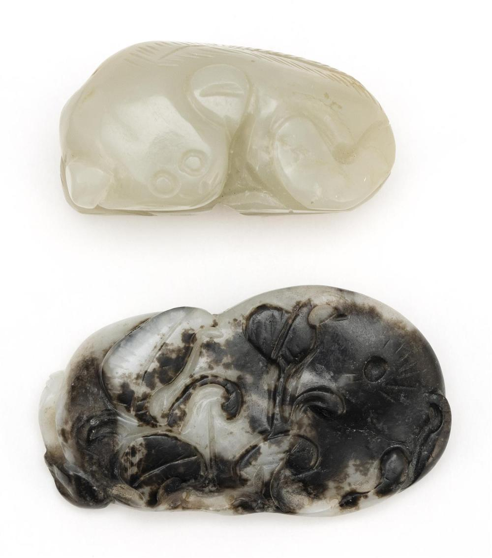 """TWO CHINESE CARVED JADE PIECES 1) Nephrite in the form of a reclining animal. Length 2"""". Mounted on a wood stand. 2) Black and white..."""