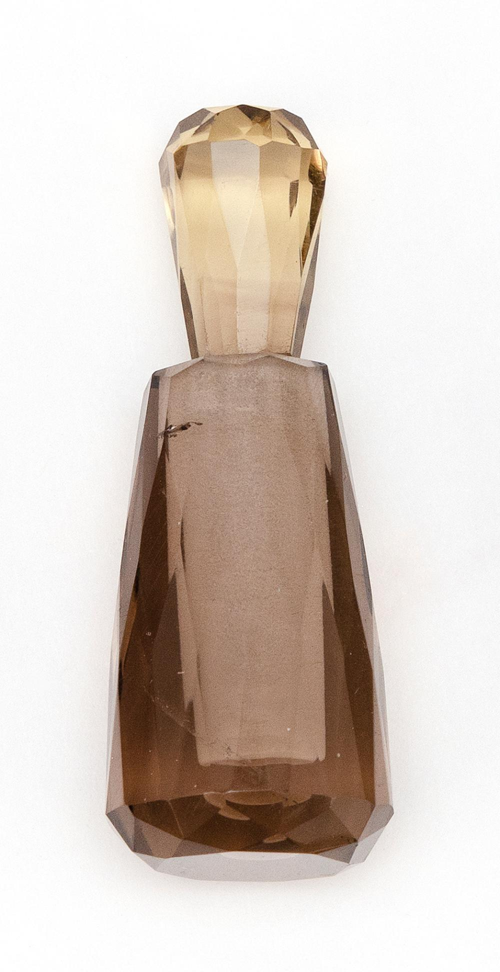 "CHINESE SMOKY QUARTZ MINIATURE PERFUME BOTTLE In a faceted tapered design with a teardrop stopper. Height 2""."