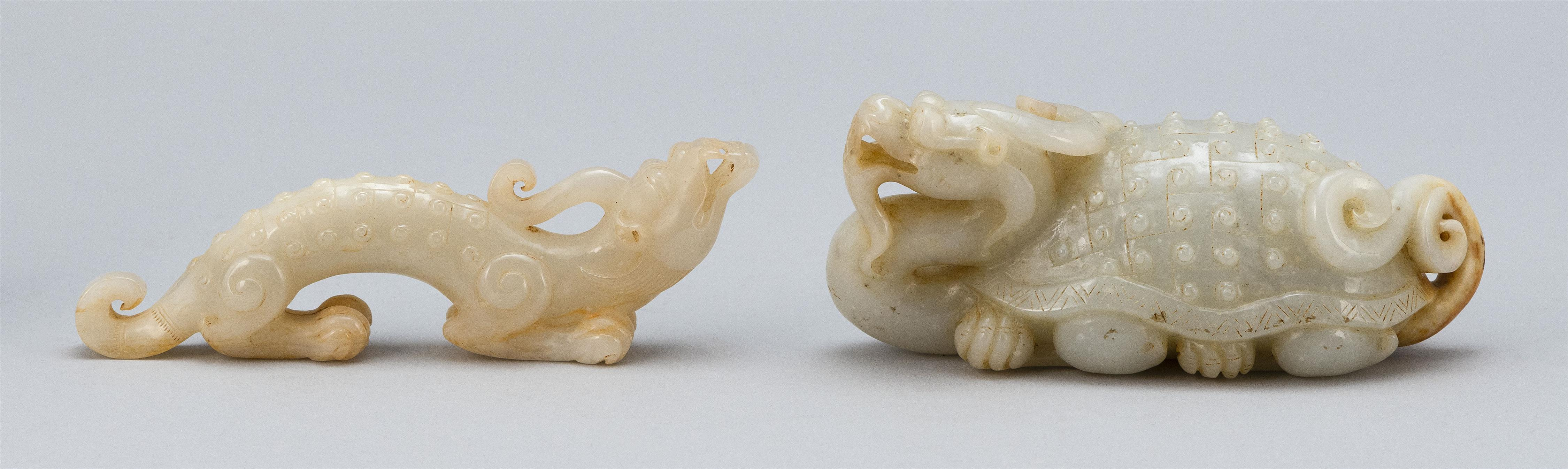 TWO CHINESE SIMULATED WHITE JADE DRAGON CARVINGS One in the form of a dragon/turtle (Bixi). Both with raised hobnail decoration. Len...