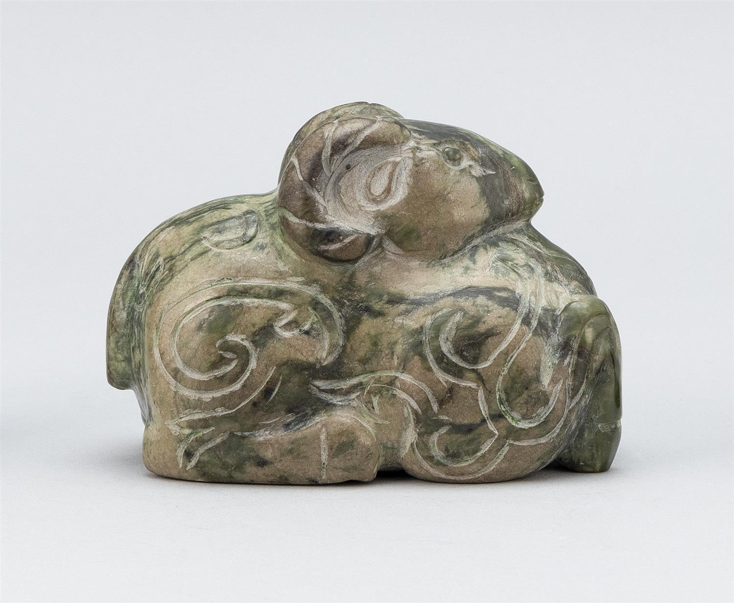 """CHINESE CARVED MOTTLED GREEN HARDSTONE FIGURE OF A RECLINING RAM Height 3.5"""". Length 5"""". Provenance: A private Florida Collection."""