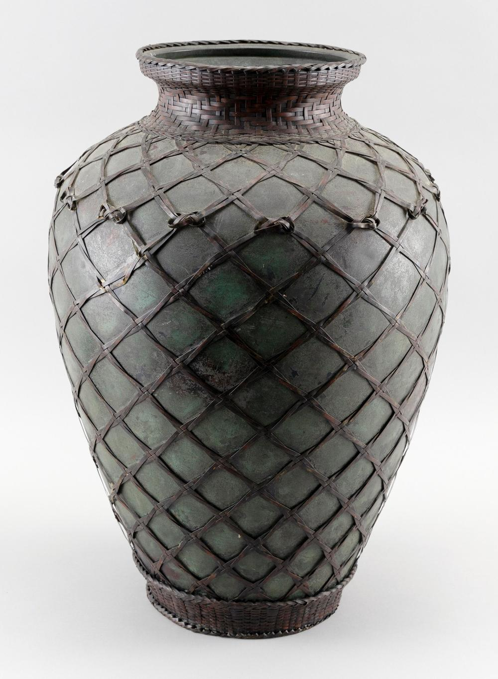JAPANESE PATINATED BRONZE VASE In urn form, with overlaid metal Ikebana-style basketry. Height 19