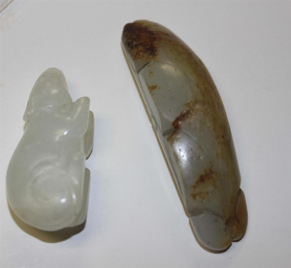 TWO CHINESE NEPHRITE JADE TOGGLES One in the form of a peapod with russet skin tones, length 2.5